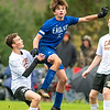 CHINA, ME - OCTOBER 26: Cape Elizabeth's Ander Erickson, left, watches Erskine Academy's Jack Blais head the ball during a Class B South soccer quarterfinal game Tuesday October 26, 2021 at Erskine Academy in China. (Staff photo by Joe Phelan/Staff Photographer)