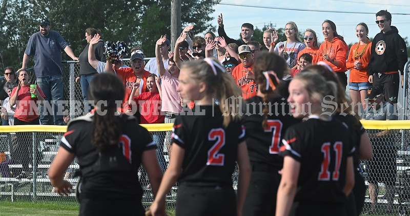 3353# 14494# BREWER, MAINE JUNE 16, 2021. Winslow supporters are shown with their team after Winslow beat Nokomis in the Class B North softball championship game in Brewer, Maine Wednesday June 16, 2021. (Rich Abrahamson/Morning Sentinel)