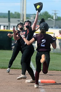 3353# 14494# BREWER, MAINE JUNE 16, 2021. Winslow first baseman Lilly Harvey snares a high throw to put out Nokomis runner Megan Watson at first base during the Class B North softball championship game in Brewer, Maine Wednesday June 16, 2021. (Rich Abrahamson/Morning Sentinel)