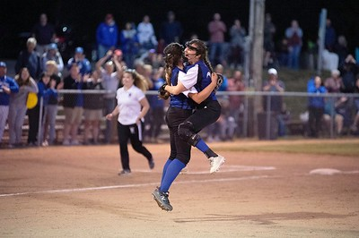 Searsport High School pitcher Adriana Lang, left, and Makenzie Alley celebrate Wednesday their Class D South regional championship at St. Joseph's College in Standish. Photos by Daryn Slover/Sun Journal