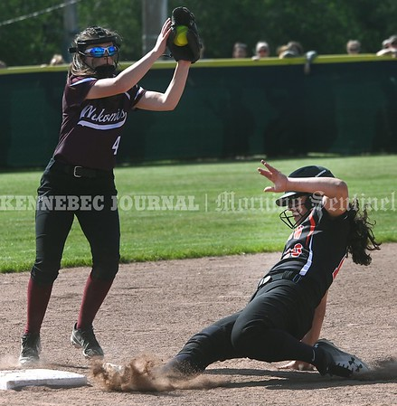 3353# 14494# BREWER, MAINE JUNE 16, 2021. WinslowÕs Harly Pomerleau skids safely into third base as Nokomis third baseman Hope Brookes fields the throw during the Class B North softball championship game against Nokomis in Brewer, Maine Wednesday June 16, 2021. (Rich Abrahamson/Morning Sentinel)
