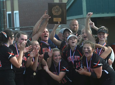 3353# 14494# BREWER, MAINE JUNE 16, 2021. Winslow players celebrate their victory and hold their plaque after defeating Nokomis in extra innings during the Class B North softball championship game in Brewer, Maine Wednesday June 16, 2021.(Rich Abrahamson/Morning Sentinel)