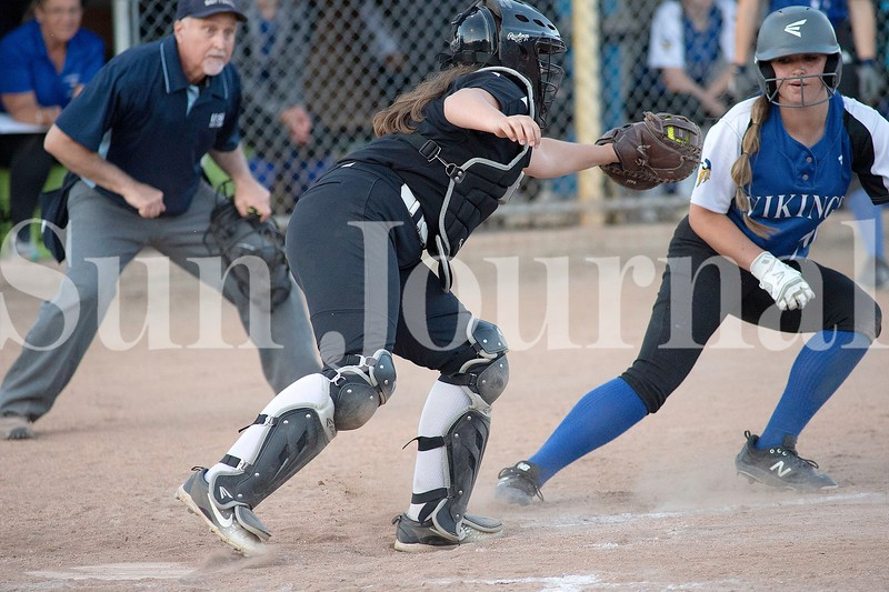 Saint Dominic High School catcher Lucy Frenette attempts to tag Searsport baserunner Adriana Lang during a rundown between home plate and third base Wednesday. Lang made it back to third safely. Photos by Daryn Slover/Sun Journal