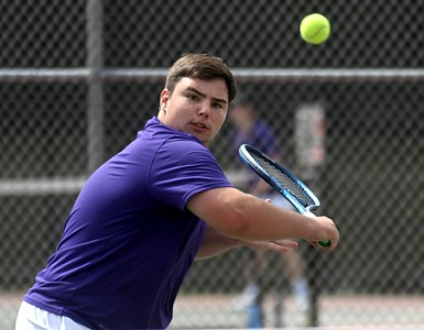14415# 01tennis HAMPDEN, MAINE JUNE 10 2021. Waterville's Owen Evans hits a backhand while competing against John Baptist's Max Poth during the No. 2 singles match in Hampden, Maine Thursday June 10, 2021. (Rich Abrahamson/Morning Sentinel)