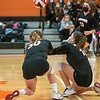 GARDINER, ME - OCTOBER 21: Gardiner's Emily Grady, 30, left, and Yana Montell, 10, dig for the ball during volleyball game Thursday October 21, 2021 in the James A. Bragoli Memorial Gym at Gardiner Area High School. (Staff photo by Joe Phelan/Staff Photographer)