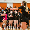 GARDINER, ME - OCTOBER 21: Gardiner Tigers celebrate after beating Lakes Region in a volleyball playoff game Thursday October 21, 2021 in the James A. Bragoli Memorial Gym at Gardiner Area High School. (Staff photo by Joe Phelan/Staff Photographer)
