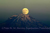 Full Moon rising through Mt. Rainier.