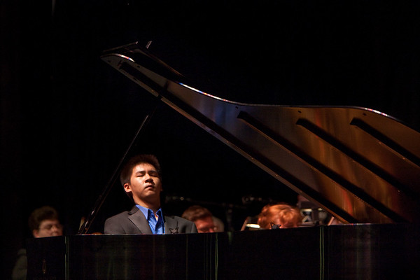 Conrad Tao, pianist performs with the Russian National Orchestra, with Constantine Kitsopoulos, conductor at the fourth annual Festival of the Arts BOCA in Boca Raton, Florida.