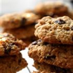 Oatmeal Raisin Cookies<br /> <br /> 1 cup  Honey<br /> 3/4 cup  Water<br /> 2/3 cup  Oil<br /> 1/2 cup  Chopped nuts or seeds<br /> 1 1/2 cups  Raisins or carob ships<br /> 1 1/2 cups  Oat flour<br /> 1 tsp  Vanilla<br /> 1 1/2 tsp  Salt<br /> 1 1/2 tsp  Lemon extract<br />   4 2/3 cups  Quick Oats<br /> <br /> Make oat flour by blending 1 1/2 cups quick or rolled oats.  Stir together all ingredients except quick oasts.  mix in remaining 4 2/3 cups of oats.  Let dough sit 10 minutes.  To shape the easiest way use a cookie scoop that holds about 2 tablespoons.  Periodically moisten scoop to keep dough from sticking and lightly flatten with a fork.  Place on oiled cookie sheets and bake at 350 degrees for 20 minutes or until light golden brown.  Makes 3 dozen.  Let cool 5 minutes before removing from cookie sheet.