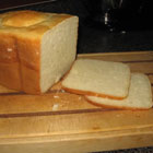 Gluten-free White Bread for Bread Machine<br /> <br />     *   3 eggs<br />     * 1 tablespoon cider vinegar<br />     * 1/4 cup olive oil<br />     * 1/4 cup honey<br />     * 1 1/2 cups buttermilk (or equivilent substitue) at room temperature<br />     * 1 teaspoon salt<br />     * 1 tablespoon xanthan gum<br />     * 1/3 cup cornstarch<br />     * 1/2 cup potato starch<br />     * 1/2 cup soy flour<br />     * 2 cups white rice flour<br />     * 1 tablespoon active dry yeast<br /> <br />    1. Place ingredients in the pan of the bread machine in the order recommended by the manufacturer.<br />    2. Select the sweet dough cycle. Five minutes into the cycle, check the consistency of the dough. Add additional rice flour or liquid if necessary.<br />    3. When bread is finished, let cool for 10 to 15 minutes before removing from pan.