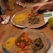 "Gluten-free Injera<br /> <br /> ""This is the staple bread of Ethiopia. It is traditionally made with teff, a very finely milled millet flour. Regular millet flour from a health food store will work fine. Use this bread to sop up the flavors of spicy stews.""<br /> <br />     *   1 tablespoon active dry yeast<br />     * 5 cups warm water (110 degrees F/45 degrees C)<br />     * 1 teaspoon honey<br />     * 3 cups finely ground millet flour<br />     * 1/4 teaspoon baking soda<br /> <br />    1. Dissolve yeast in 1/4 cup of the water. Allow to proof and add the remainder of the water and the millet flour. Stir until smooth and then cover. Allow to stand at room temperature for 24 hours.<br />    2. Stir the batter well and mix in the baking soda.<br />    3. Heat a large non-stick skillet over medium heat. Pour about 1/3 cup of the batter into the pan in a spiral pattern to cover the bottom of the pan evenly. Tilt the pan to quickly even out the batter. Cover the pan and allow to cook for about 1 minute. The bread should not brown but rather rise slightly and very easy to remove. It is cooked only on one side. This top should be slightly moist. Remove to a platter and cool. Stack the cooked breads on a plate."