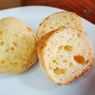 Gluten-Free Brazilian Cheese Bread<br /> <br /> * 1/2 cup olive oil or butter<br />     * 1/3 cup water<br />     * 1/3 cup milk or soy milk<br />     * 1 teaspoon salt<br />     * 2 cups tapioca flour<br />     * 2 teaspoons minced garlic<br />     * 2/3 cup freshly grated Parmesan cheese<br />     * 2 beaten eggs<br /> <br />    1. Preheat oven to 375 degrees F (190 degrees C).<br />    2. Pour olive oil, water, milk, and salt into a large saucepan, and place over high heat. When the mixture comes to a boil, remove from heat immediately, and stir in tapioca flour and garlic until smooth. Set aside to rest for 10 to 15 minutes.<br />    3. Stir the cheese and egg into the tapioca mixture until well combined, the mixture will be chunky like cottage cheese. Drop rounded, 1/4 cup-sized balls of the mixture onto an ungreased baking sheet.<br />    4. Bake in preheated oven until the tops are lightly browned, 15 to 20 minutes.