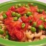 Peas with Tomato Sauce<br /> <br /> 1 Box Baby Peas<br /> ¾ Cup Tomato Sauce (Gia Russa Tomato & Basil or plain sauce and add ¼ tsp basil)<br /> 1 Onion, chopped or 3 Tbs Onion Flakes<br /> 1 Tbs Sweetener (Xylitol/Fructose)<br /> 1 Vegetable Bouillon Cube<br /> 1 Tbs Extra Virgin Olive Oil<br /> 1 Cup Cooked Brown Rice<br /> <br /> Pour tomato sauce in a deep pan and begin heating over medium heat.  Add the chopped onion or onion flakes and the sweetener you have chosen (sugar, fructose, Xylitol, etc.)<br /> Add the baby peas  and stir into the sauce.  Add the vegetable bouillon cube and cover the pan.  Lower the heat enough to allow the peas to simmer—stirring every ten minutes or so.  (If the mixture gets too dry add more vegetable broth,  Remember, this is being made to your taste so taste the mixture as it is booking.  Feel free to ad a bit more bouillon or salt or pepper if you like.<br /> <br /> As the peas soften, take the lid off to allow the liquid to dry.  You wish most of the liquid from the broth to be consumed.  Cook for about 30-40 minutes or until the peas are soft to your taste<br /> <br /> Cook the brown rice in a separate pan.  Place about a cup of rice in a bowl, sprinkle with a Tbs of extra virgin olive oil, top with the peas.