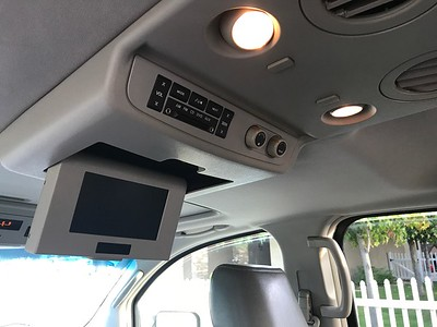 "Overhead console with 8"" DVD entertainment system and rear audio and air conditioning controls"