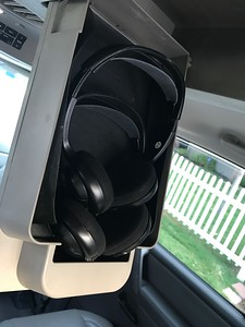 "Flip down wireless stereo headsets for rear seat passengers (allows adults in front to not have to listen to ""Frozen"" for the millionth time!"