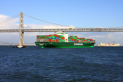 Huge container ship under the Bay Bridge, shot from docked Larkspur ferry at the S.F. Ferry Building.