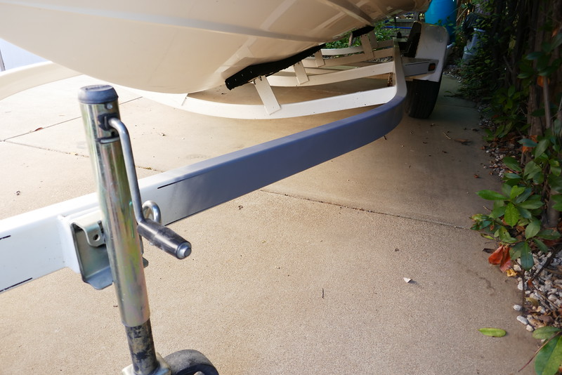 There were a few spots on the frame that had had the paint chipped and the exposed metal had rusted. I used the vibrating sander with some 280 grit to clean up the rust and prep the area. <br /> <br /> The whole trailer has tiny rust spots but they are too small  to bother painting the whole trailer. We only boat in fresh water. Salt water would have long ago destroyed the trailer.<br /> <br /> I wiped the frame down with some alcohol and primed it. After it hardened I sanded the primer with some 500 grit to prep it for painting.