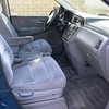 Front seats have no tears, rips, holes, or stains. Both are manual and slide forward and back. Both have arm rests.