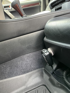Mic stuck to the front of the driver's seat with a magnet.