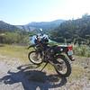 John's Suzuki in front of the Shasta Dam