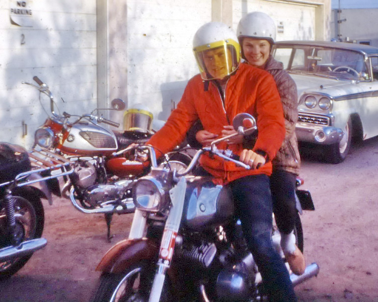 My first motorcycle was this old Suzuki. Not fast. Not comfortable, and it smoked like a chimney. I didn't own this very long. First wife on back.