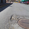 This pothole is on Main Street in Fitchburg. SENTINEL & ENTERPRISE/JOHN LOVE
