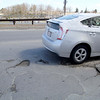 This pothole is on Electric Ave. in Fitchburg. SENTINEL & ENTERPRISE/JOHN LOVE