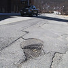 This pothole is on Rollstone Street in Fitchburg. SENTINEL & ENTERPRISE/JOHN LOVE