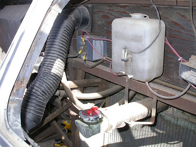 View of the leaking radiator cap and battery isolator wiring. Leaking cap turned out to be a dent in the filler which was easily fixed.