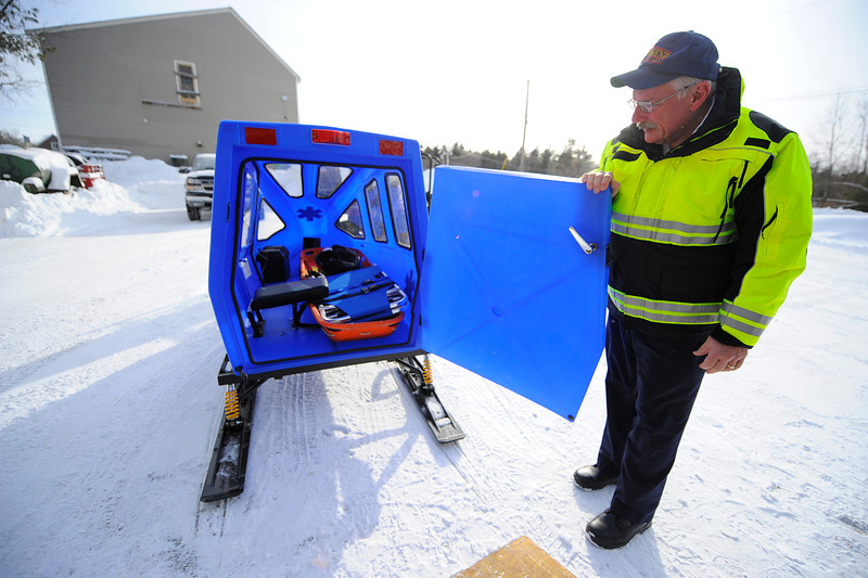 Townsend Fire Chief Donald Klein shows the inside of the snow-ambulance which contains a backboard / cot, a heater, and a battery to enable lighting, Friday.<br /> SENTINEL & ENTERPRISE / BRETT CRAWFORD