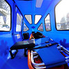 The inside of Townsend fire department's snow-ambulance which contains a backboard / cot, a heater, and a battery to enable lighting, Friday as firefighter Leon Niemiera walks by.<br /> SENTINEL & ENTERPRISE / BRETT CRAWFORD