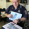Fitchburg police officer Paul McNamara the departments traffic officer talks about some of the traffic problems in the city as he shows off a traffic study he has in his office from 2010 that outlined many of the issues. SENTINEL & ENTERPRISE/JOHN LOVE