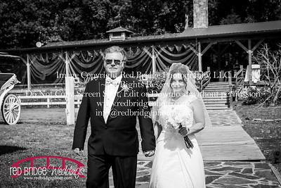 Summer-wedding-photography-of-Sarah-and-David-at-Bennett-Bunn-Plantation-with-bride-arriving-on-a-horse-25