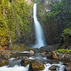 Hawaii, Maui, Nahiku, Dramtic waterfall and stream in lush valley