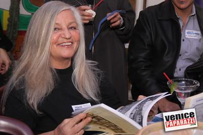 Venice Carnevale's Miriam Moore checks out Elanye Alexander's Venice Book