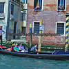 Gonolier plys his trade along the Grand Canal in Venice.