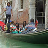 Gondolier navigating through one of the many canals of Venice.