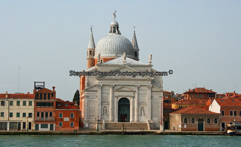 A large Church and other buildings are seen along Venice's Grand Canal.