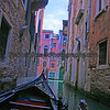 Gondola ride down a canal in Venice, Italy near St. Mark's Square.
