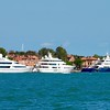 Three modern superyachts moored in Venice