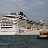 The MSC Poesia passing the water bus station of Palanca on Giudecca