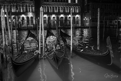 The gondola is a traditional, flat-bottomed Venetian rowing boat, well suited to the conditions of the Venetian lagoon. It is similar to a canoe. It is propelled by a gondolier, who uses a rowing oar, which is not fastened to the hull, in a sculling manner and acts as the rudder