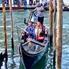 Gondola arriving at the Rialto Bridge