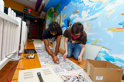 Students help update the Animal Run project at the Terre Haute Children's Museum.