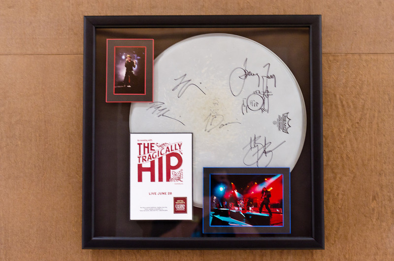 Also added framed band memorabilia - signed SOLD OUT Tragically Hip Poster with signed drum head and show photos.