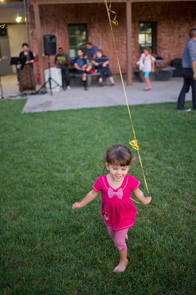 Lalea Munoz stands and runs with a balloon during Fuel's 3rd birthday celebration. Fuel serves as the 20s and 30s Ministry for Saddleback Church in Lake Forest, Calif.