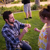 Brent Stephens ties a balloon to Cassidy Odom's arm during Fuel's 3rd birthday celebration. Fuel is the 20s and 30s ministry at Saddleback Church in Lake Forest, Calif. (Photo by Tommy Huynh)