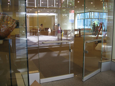 Double glass doors leading from 54th Street entrance to lobby