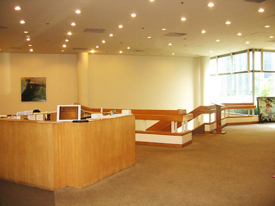 Lobby (including receptionist island and stairwell to the Sanctuary) seen from glass doors leading to 54th street (main entrance)