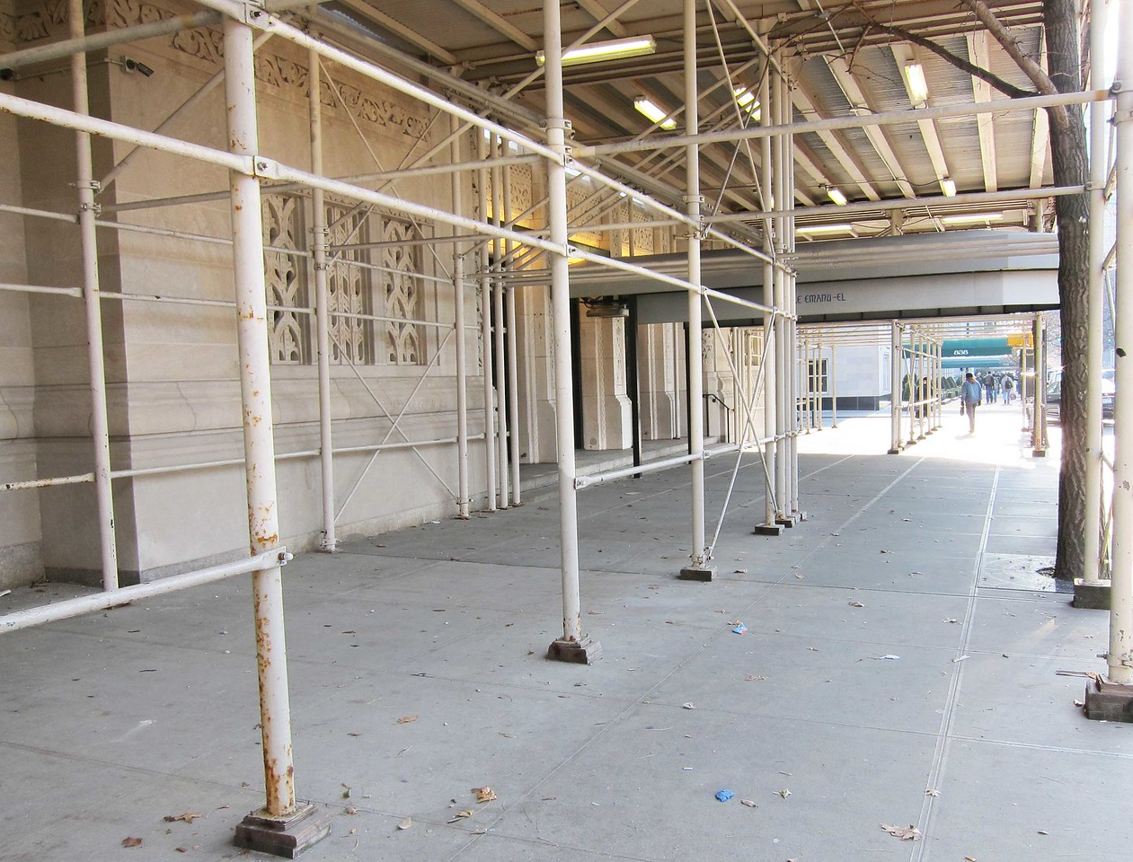 View from the level of the load-in doors to the main entry doors at the awning, seen from the north along 5th Avenue.